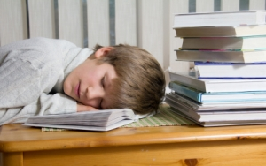 Boy fell asleep during reading.